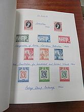 FOUR ALBUMS OF VARIOUS FOREIGN POSTAGE STAMPS