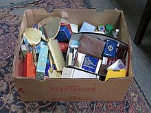 BOX CONTAINING VARIOUS COSMETICS.