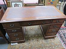 MAHOGANY SEVEN DRAWER LEATHER TOPPED WRITING DESK.