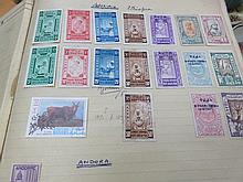 THREE ALBUMS OF VARIOUS POSTAGE STAMPS AND CATALOGUES.