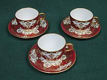 SET OF THREE ROYAL CROWN DERBY CUPS AND SAUCERS