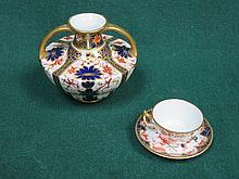 SMALL ROYAL CROWN DERBY TWO HANDLED VASE AND MINIATURE CUP AND SAUCER
