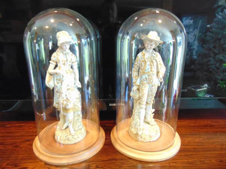 Parian bisque porcelain German hand painted figurines of a young boy and maiden, 17