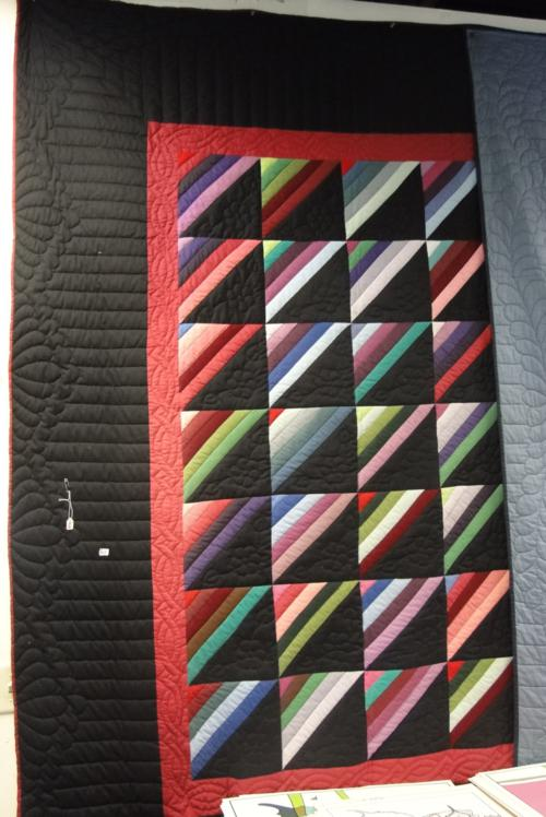 A hand-made Amish quilt in good condition, multi-colored