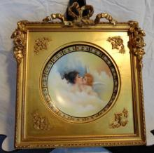 Hand painted Limoges plate depicting young beauty with winged angel, artist signed, in elaborate gold leaf frame (10
