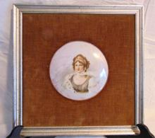 Possibly Limoges, hand painted and framed oval porcelain plaque of Queen Louise with lustre glaze in elaborate gold leaf frame (plaque is 5.5