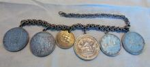 Heavy silver linked bracelet w/6 silver coins to include: 1953 Canadian Dollar; 1950 Mexican Pesos; 1958 South African Dollar; 1910 Mexican Pesos; 1852 Dutch Guilder; and a 1939 Dutch Guilder (170.1 gm w/chain).