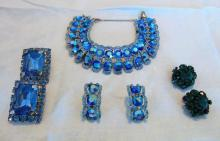 Large blue aurora borealis rhinestone bracelet of important size, along with a pair of matching earrings and 2 other pair of rhinestone earrings.