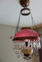 Hanging kerosene chandelier w/pink case glassed shade, electrified.