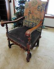 Mahogany arm chair w/ scrolled arms and fancy needle and petty point depicting maiden and young gentleman (43