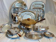 Large assortment of quality silver-plate by various manufacturers, to include: platters, water pitchers, candy dishes, covered vegetables, ash catcher, chafing dish, and more.