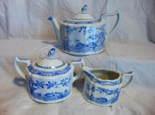 Group of Furnivals Quail in blue, Made in England, 1913, w/registry mark, consisting of: tea pot; and covered creamer & sugar (interior chip to creamer noted, finial has been re-glued).