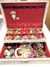 Jewelry box filled with costume jewelry.