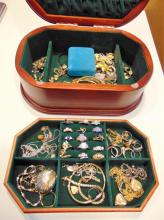 Quality mahogany jewelry box filled with costume jewelry: rings, brooches, bracelets and more.