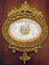 Oval framed plate depicting Grecian women with child, in very elaborate gold leaf frame, by Atlas China, 22 carat (17