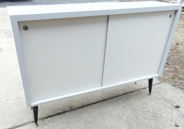Two 1950's Painted maple double door storage cabinet; Measures 33