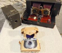 Three vintage cameras to include: Turn of the century stereo Hawkeye camera  tha