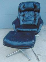 Selig Imperial No. 76204 Egg chair in black with stool. Chair has chrome legs an