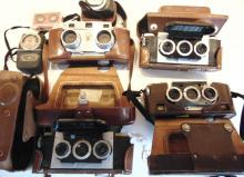 Four Realist vintage cameras in original cases in good condition; along with a W