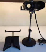 Turn of the century electrified adjustable stereopticon; along with accessories