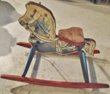 Paper lithograph wood and metal rocking horse, maker unknown; Measures 17