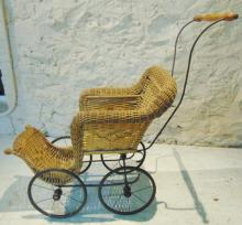 Victorian wicker doll buggy with fish scaling in good condition with original wh