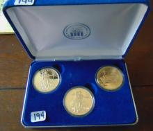National Collectors mint, three copies of the 1933 Liberty Twenty dollar.  These