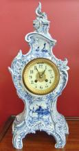 Early Rococo porcelain Delft clock that depicts flowers, boats, and windmills;