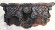 Folk art tooled leather clock shelf made by a harness maker; this unusual piece