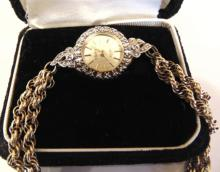 Dunbar ladies wrist watch with diamonds set in 10K gold with sapphire finial
