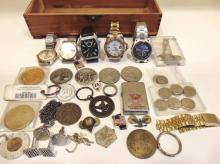 Group of men's wrist watches, medallions, cuff links, coins, and more in a men's