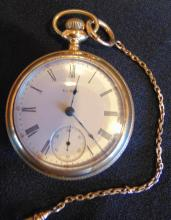 Large 1890's Elgin beveled face heavy rolled gold pocket watch; comes with a cha