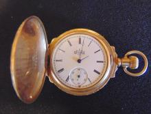 14K high plum Elgin pocket watch which weighs 60.4 grams.  It has a heavily flor