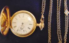 14K gold high plum hunting case pocket watch by Waltham. It weighs 61.0 grams wi