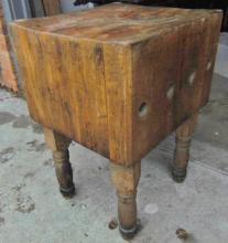 Turn of the century maple chopping block on four turned legs