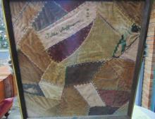 Framed fragment of a crazy quilt dated 1904 by Tillie Hoffmann; Measures 17