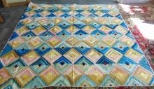 1850's - 1860's crazy quilt in blues, pinks, greens, and browns in good conditio
