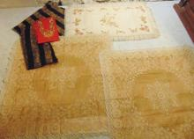 Pair of hand made large lace table throws; along with a cupid and floral table t