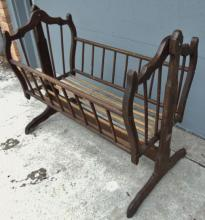 Spindled baby cradle