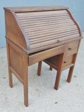 Oak child's roll top desk in original finish