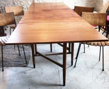 Teak large drop leaf mid-century modern dining table. The table folds up into 2
