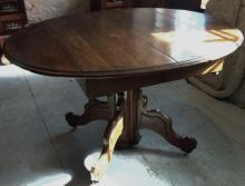 Fancy walnut Victorian round dining table with split pedestal and drop leaves in