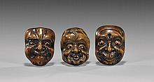 THREE ANTIQUE CARVED MASK NETSUKE