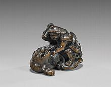 ANTIQUE WOOD NETSUKE: Figure with Tiger