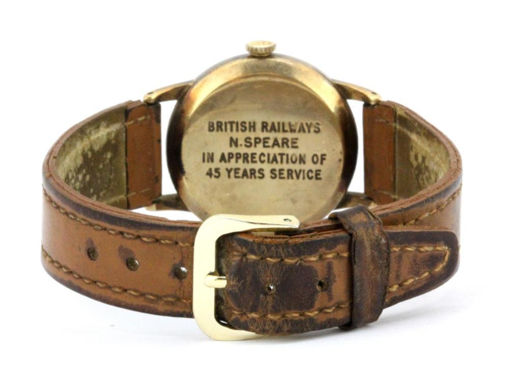 Lot 90: A gentleman's 9ct yellow gold British Railways presentation manual  wrist watch on a leather strap