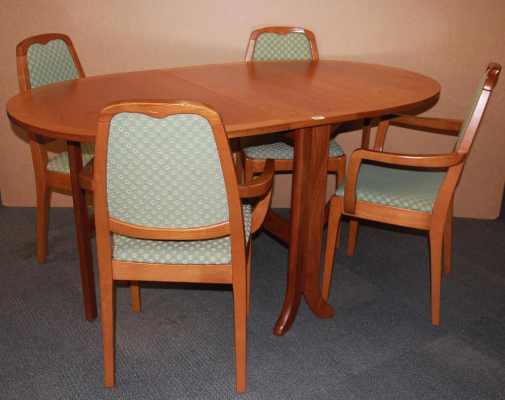 A 1970s parker knoll drop leaf teak dining table and four c