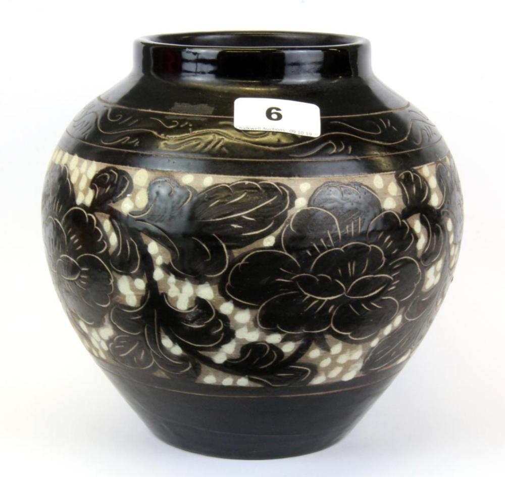 A Chinese incised brown glazed Yuan dynasty style vase, H. 19cm.