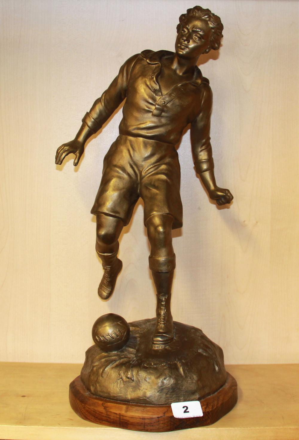 A large spelter figure of a footballer by S. (Sylvain) Kinsburger (French 1855-1935), H. 54cm.