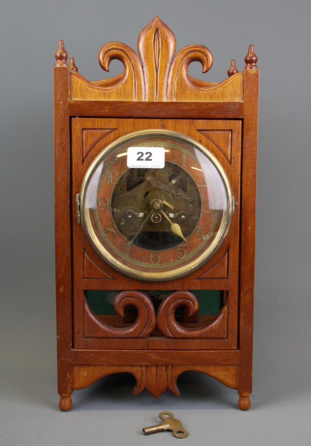 An interesting early 20th Century mahogany skeleton clock, H. 42cm.