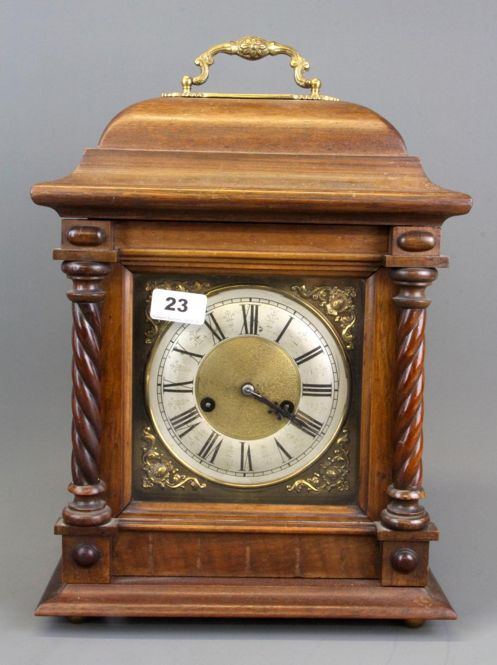 An oak bracket clock, H. 43cm.